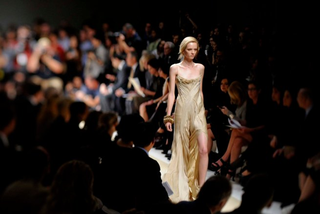 A model walks the runway in designs by Donna Karan at her fashion show during Mercedes-Benz Fashion Week in New York.